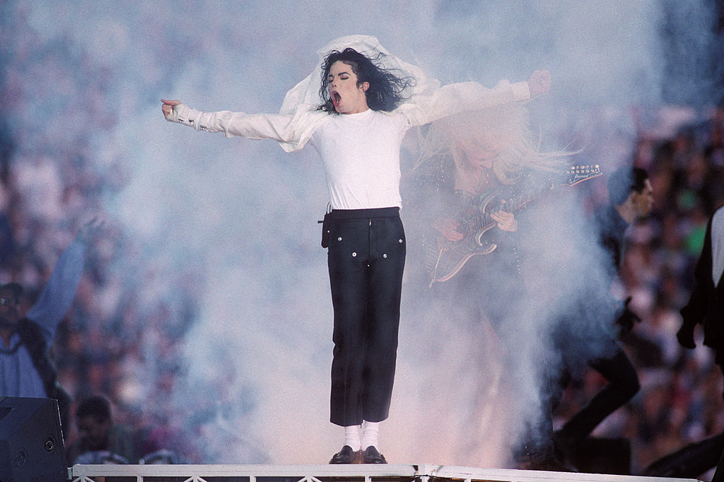 Michael Jackson on stage, head turned, with his mouth open