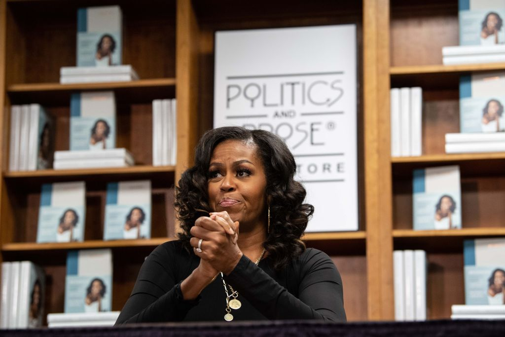 Former US first lady Michelle Obama meets with fans