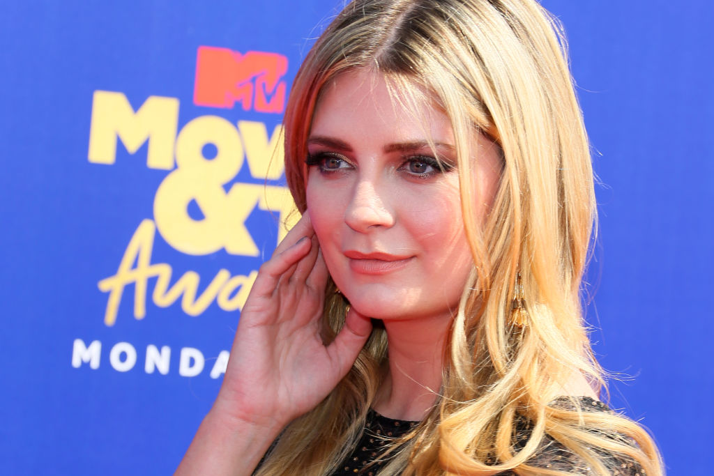 Mischa Barton looking off camera, touching her face
