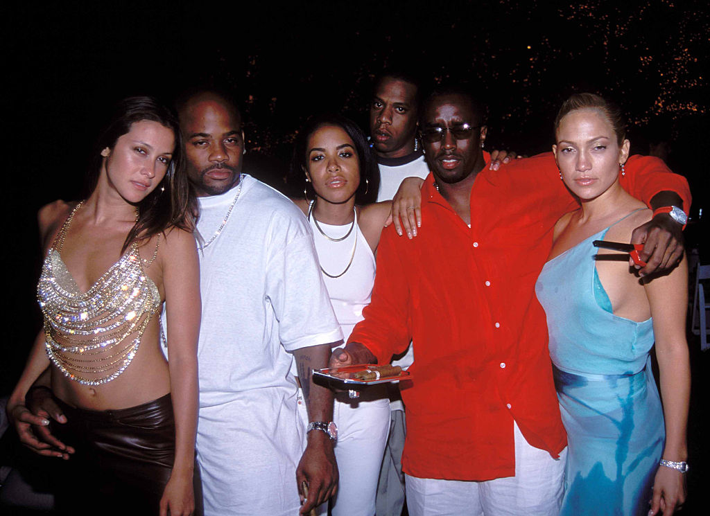 Natane Adcock, Damon Dash, Aaliyah, JAY-Z, Diddy, and Jennifer Lopez at a party in July 2000