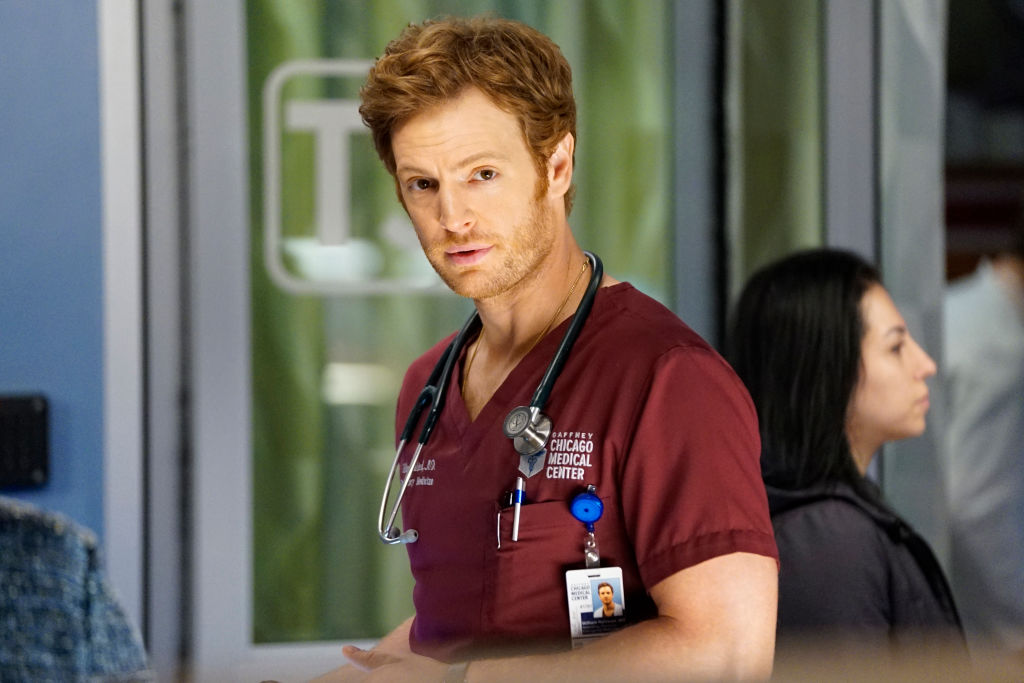 Nick Gehlfuss as Dr. Will Halstead turned toward the camera