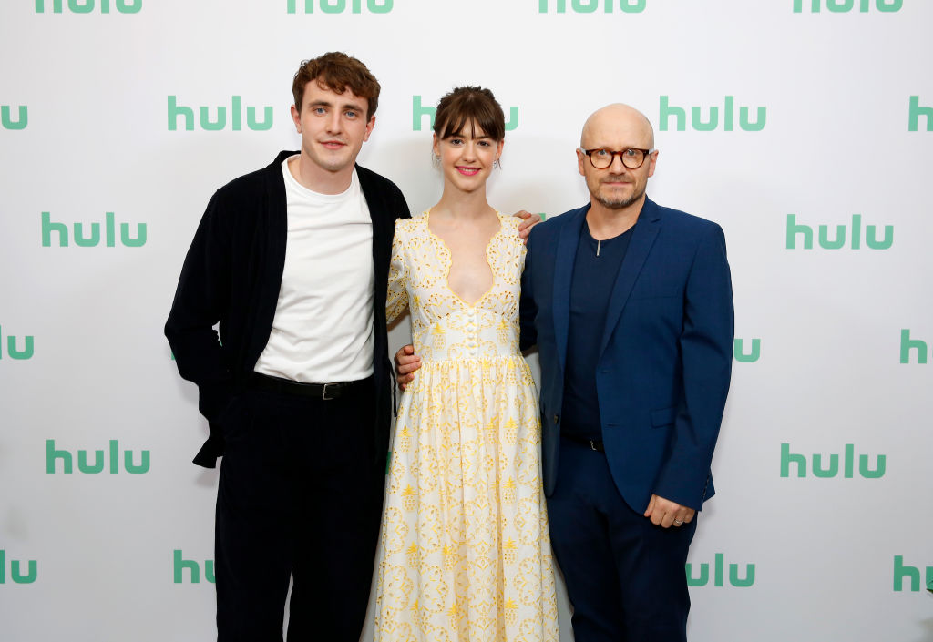 (L-R) Paul Mescal, Daisy Edgar-Jones, and Lenny Abrahamson in front of a repeating background with the Hulu logo