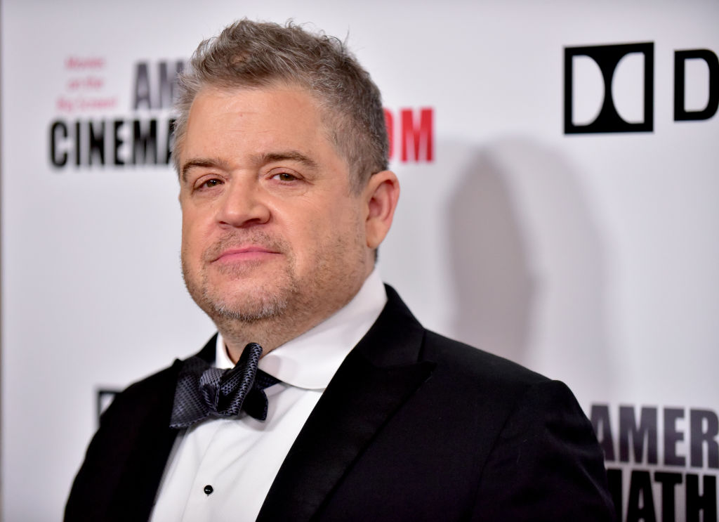 Patton Oswalt smiling slightly at the camera