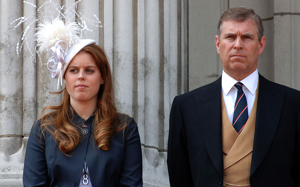 Prince Andrew, Duke of York stands with his daughter, Princess Beatrice on the balcony of Buckingham Palace