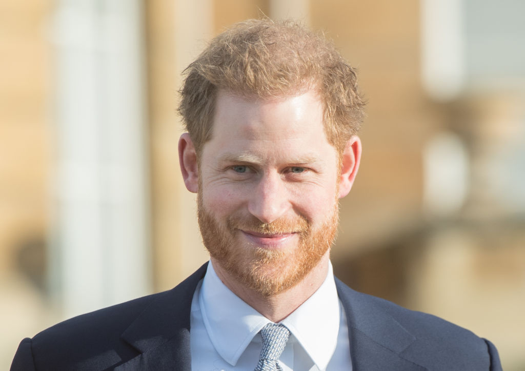 Prince Harry, Duke of Sussex, smiling looking off camera