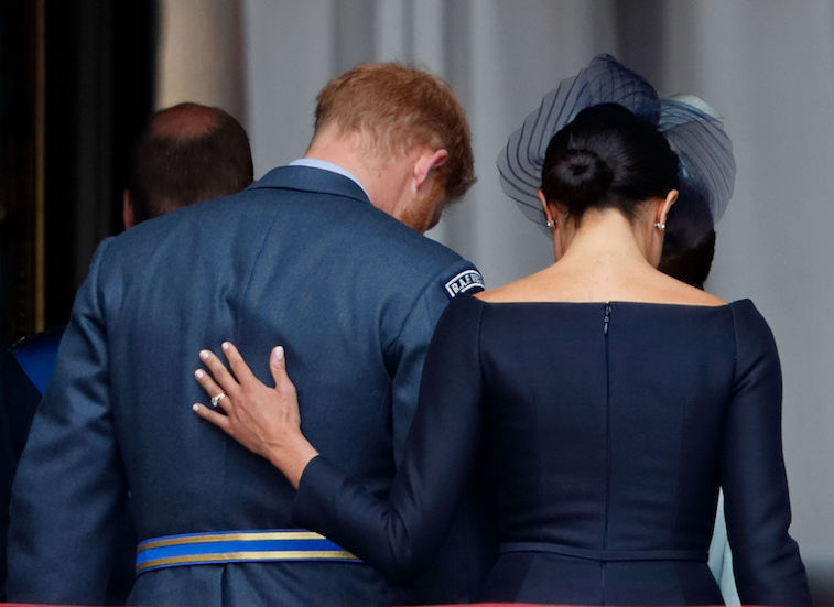 Meghan Markle often puts her hand on Prince Harry's back for reassurance.
