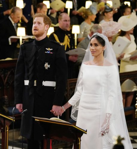 Prince Harry and Meghan Markle hold hands during their royal wedding
