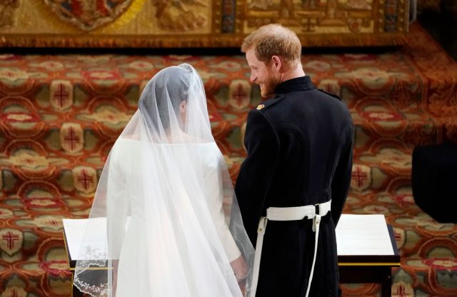 Prince Harry and Meghan Markle stand next to each other at the altar during their royal wedding