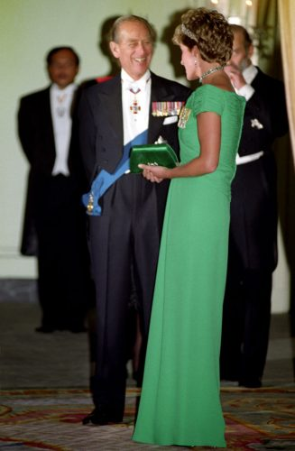 Prince Philip and Princess Diana talk at a banquet for Queen Elizabeth II
