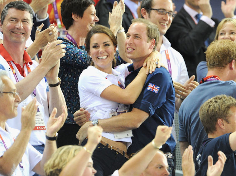 Prince William and Kate Middleton embrace at the 2012 Olympics in London