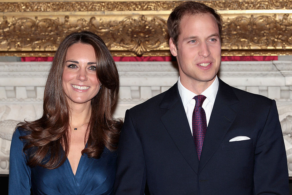 Prince William and Kate Middleton pose for photographs in the State Apartments of St James Palace for engagement photo