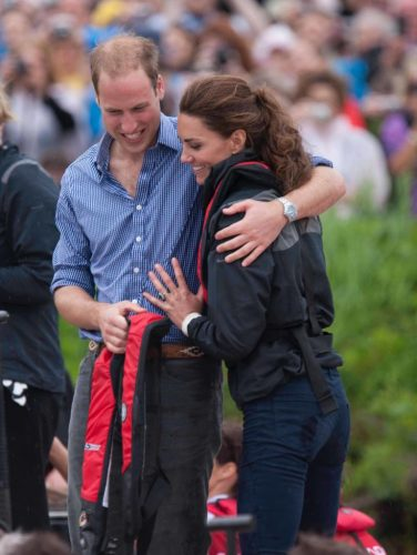 Kate Middleton and Prince William put their arms around each other