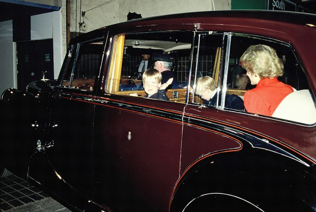 Princess Diana, Prince William, and Prince Harry in a car