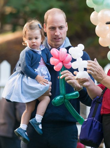 Prince William and Princess Charlotte play with balloons
