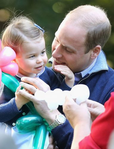 Prince William and Princess Charlotte at a children's party in Canada