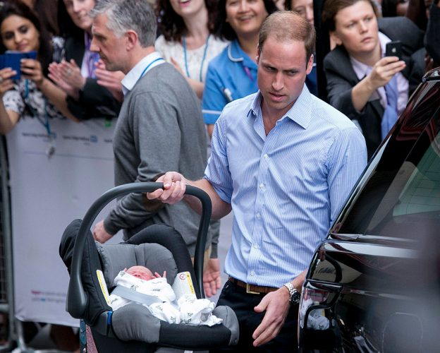 Prince William carries newborn Prince George in car seat before leaving Lindo Wing of St. Mary's Hospital, 2013