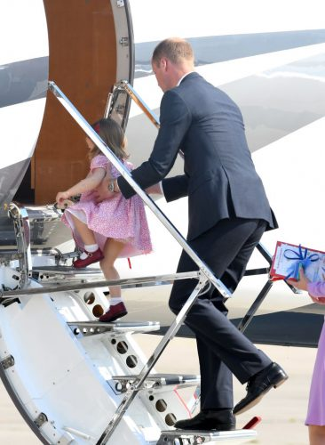 Prince William helps Princess Charlotte board a plane in Germany