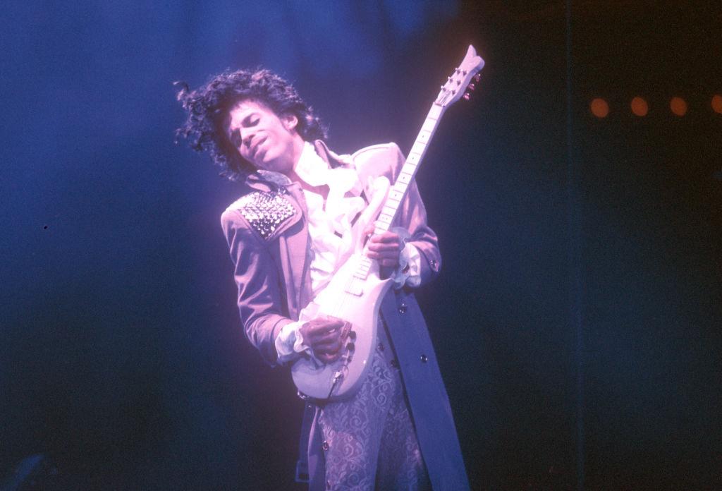 Prince playing the guitar