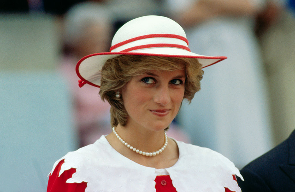 Diana, Princess of Wales, wears an outfit in the colors of Canada during a state visit to Edmonton, Alberta, with her husband