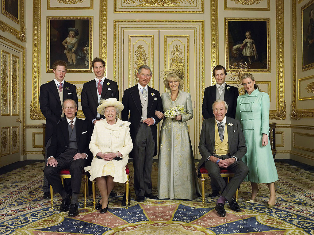 Clarence House official handout photo of the Prince of Wales and his new bride Camilla, Duchess of Cornwall, with their families (L-R back row) Prince Harry, Prince William, Tom and Laura Parker Bowles (L-R front row) Duke of Edinburgh, Britain's Queen Elizabeth II and Camilla's father Major Bruce Shand, in the White Drawing Room at Windsor Castle after their wedding ceremony, April 9, 2005 in Windsor, England