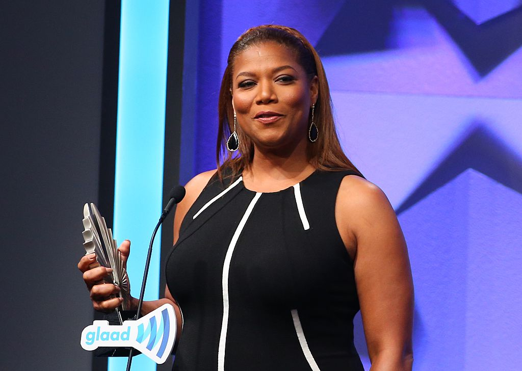 Queen Latifah accepting an award at the GLAAD Awards