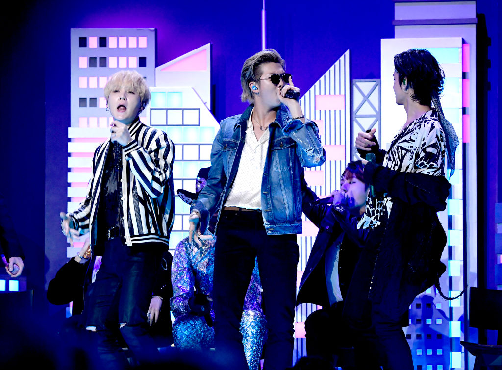 SUGA, RM, and V of BTS perform onstage during the 62nd Annual GRAMMY Awards