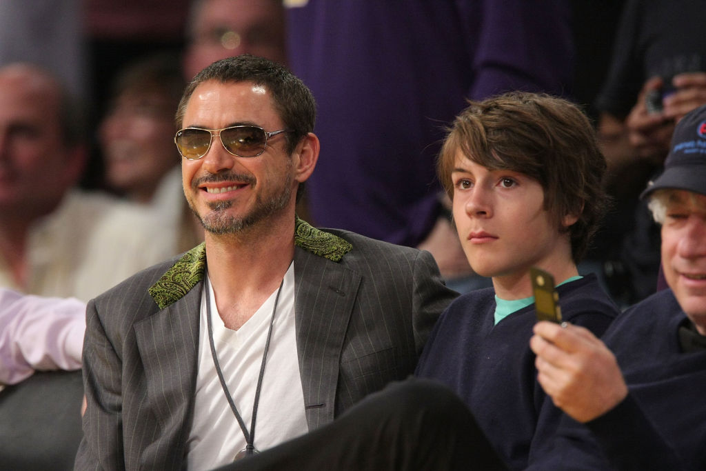 Robert Downey Jr. (L) and his son Indio Downey (R) attend the Los Angeles Lakers against Utah Jazz playoff game