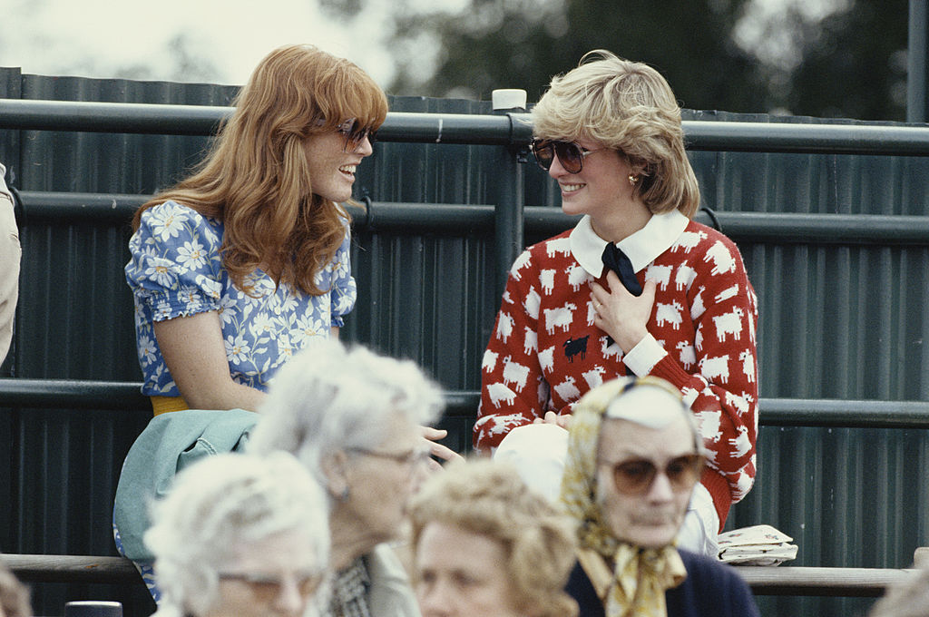 Diana, Princess of Wales (1961 - 1997) with Sarah Ferguson at the Guard's Polo Club, Windsor, June 1983. The Princess is wearing a jumper with a sheep motif from the London shop, Warm And Wonderful