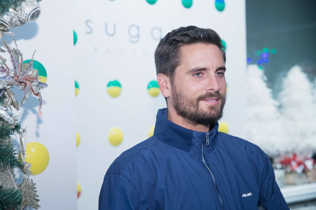 Scott Disick slightly smiling wearing a blue jacket
