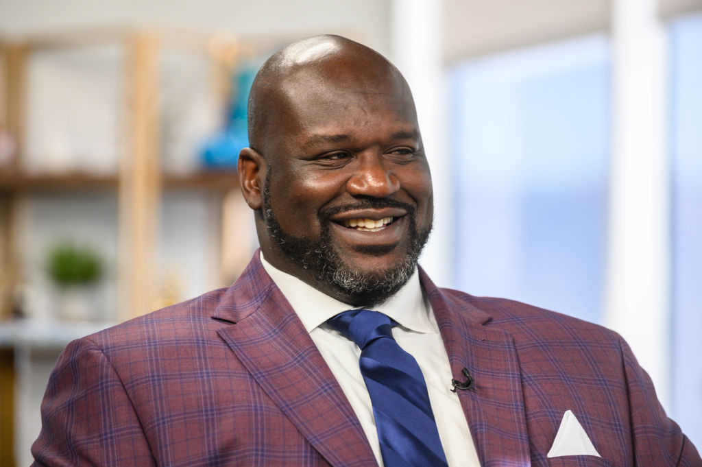 Shaquille O'Neal smiling, looking away from the camera