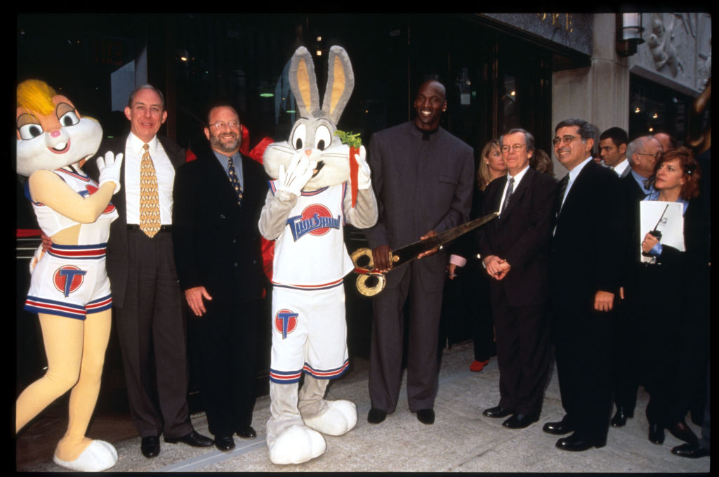 Bugs and Lola Bunny, Michael Jordan, and Warner Bros. executives stand in front of the Warner Bros. Studio store