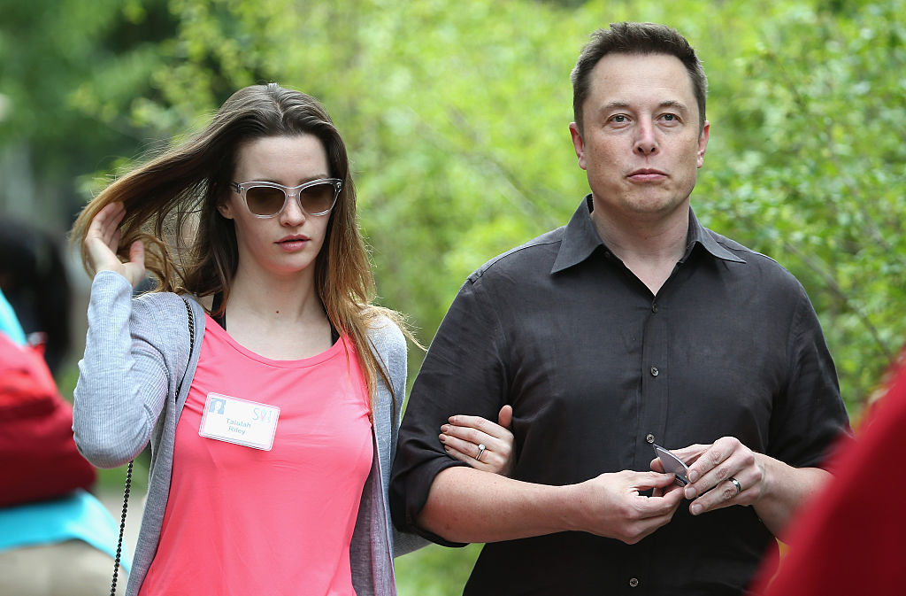 Elon Musk and his wife Talulah Riley attend the Allen & Company Sun Valley Conference
