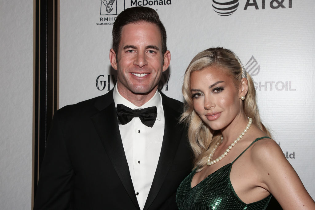 Tarek El Moussa (L) and Heather Rae Young (R) attend the Give Easy event
