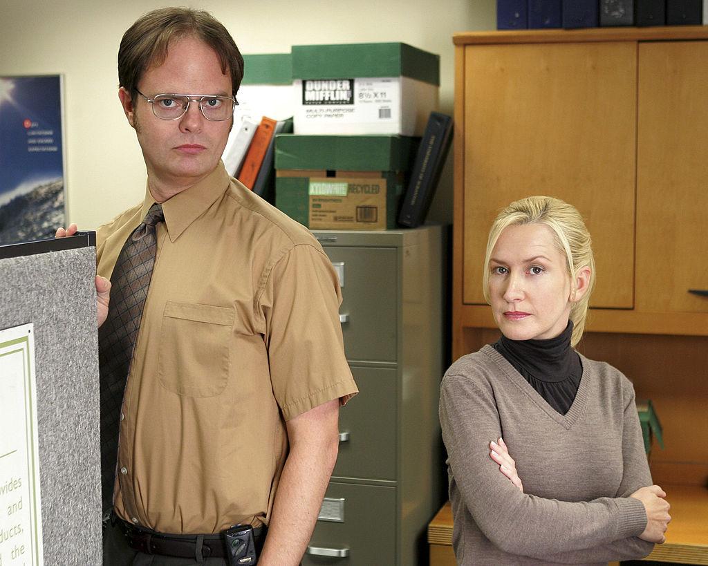 Rainn Wilson as Dwight Schrute, Angela Kinsey as Angela Martin on 'The Office'