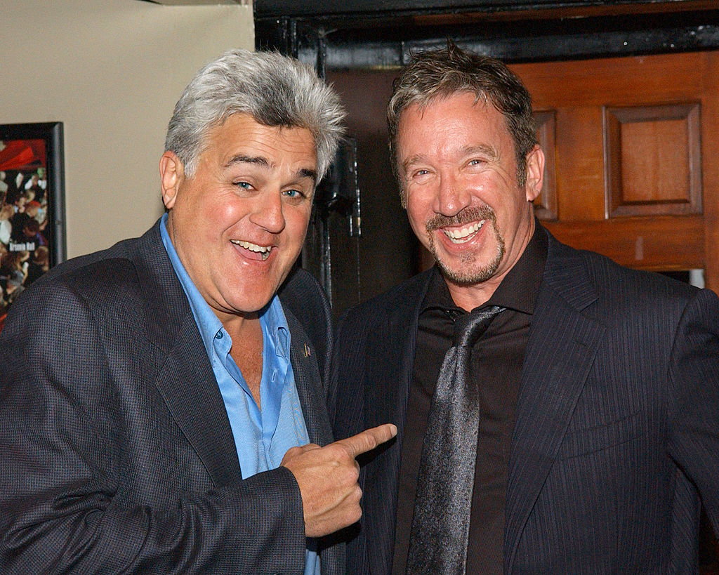 Tim Allen and Jay Leno posing for a photo at a charity event