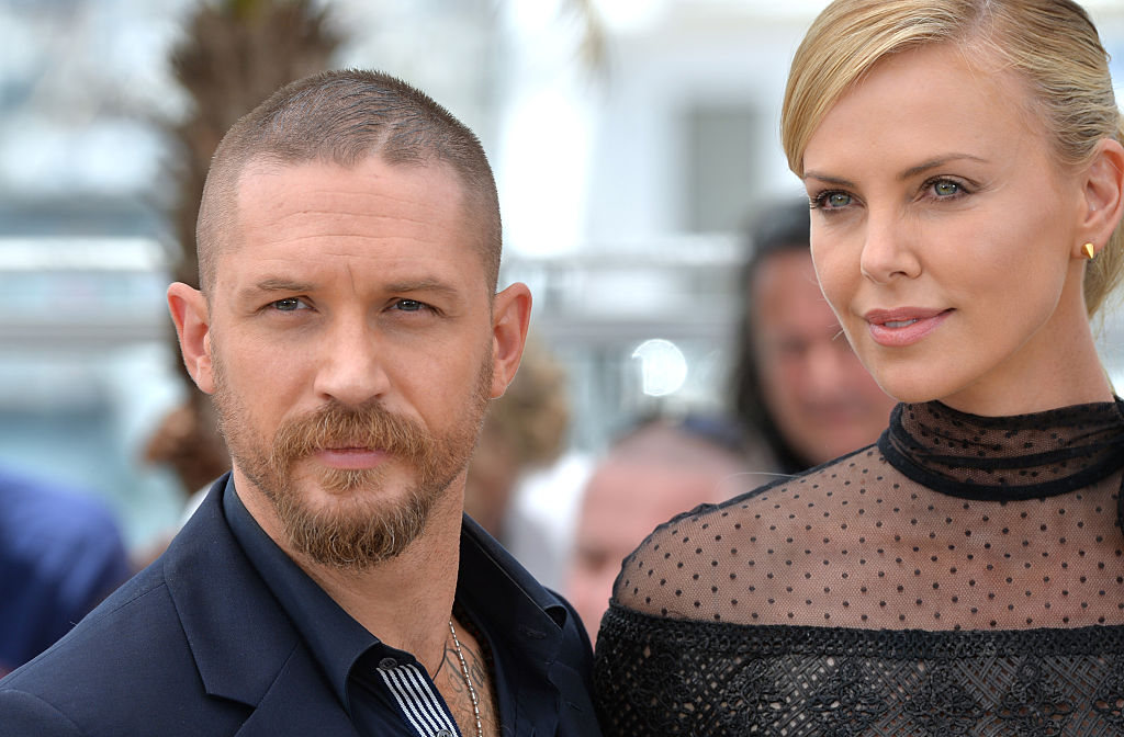 """Tom Hardy and Charlize Theron attend the """"Mad Max: Fury Road"""" photocall during the 68th annual Cannes Film Festival on May 14, 2015 in Cannes, France."""