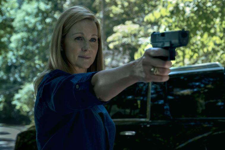 Laura Linney as Wendy Byrde pointing a gun in 'Ozark'