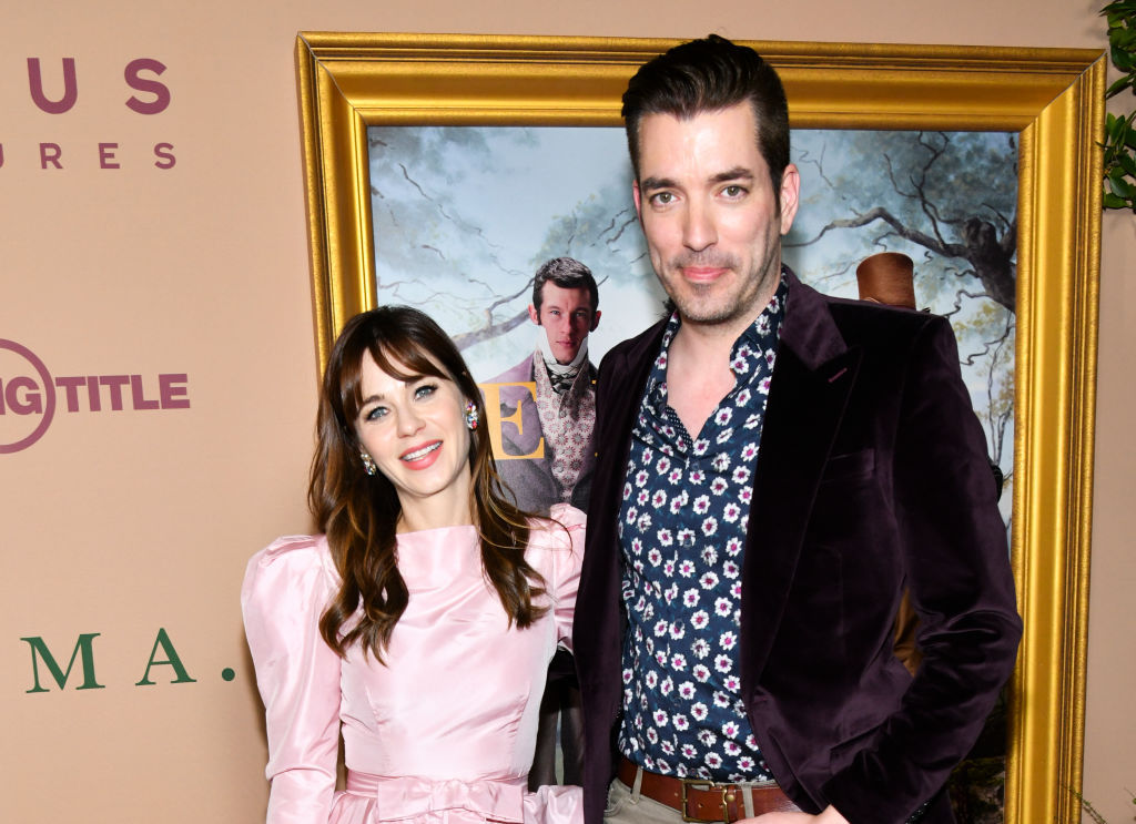 Zooey Deschanel and Jonathan Scott smiling at the camera