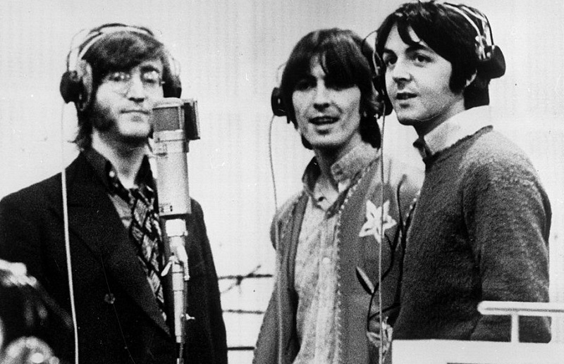 Lennon, George Harrison, McCartney at a microphone