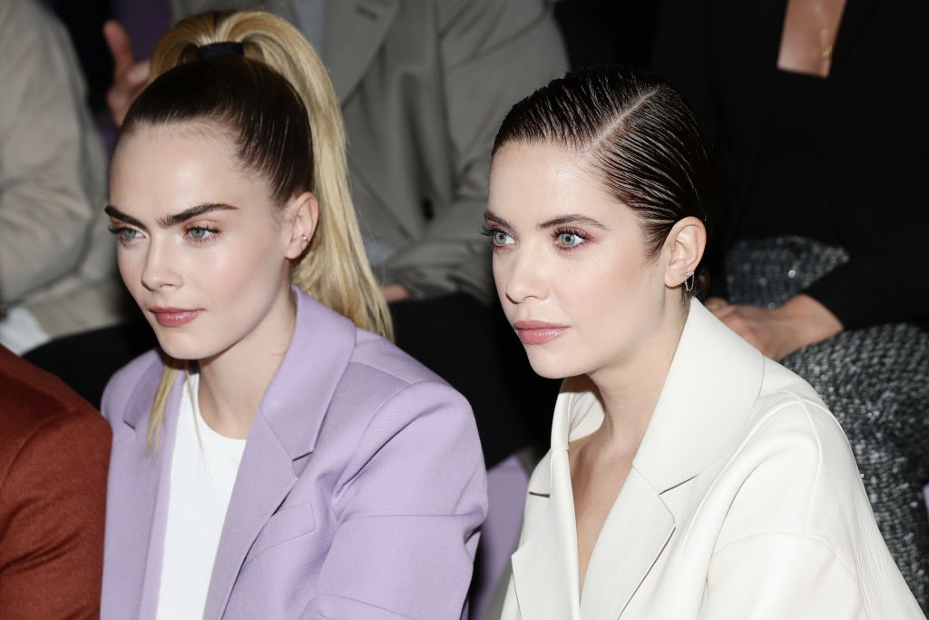 Cara Delevingne and Ashley Benson attend the BOSS fashion show during the Milan Fashion Week Fall/Winter 2020 - 2021 on February 23, 2020