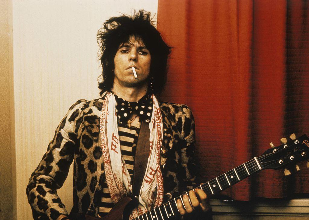 Keith Richards wearing a cheetah print jacket