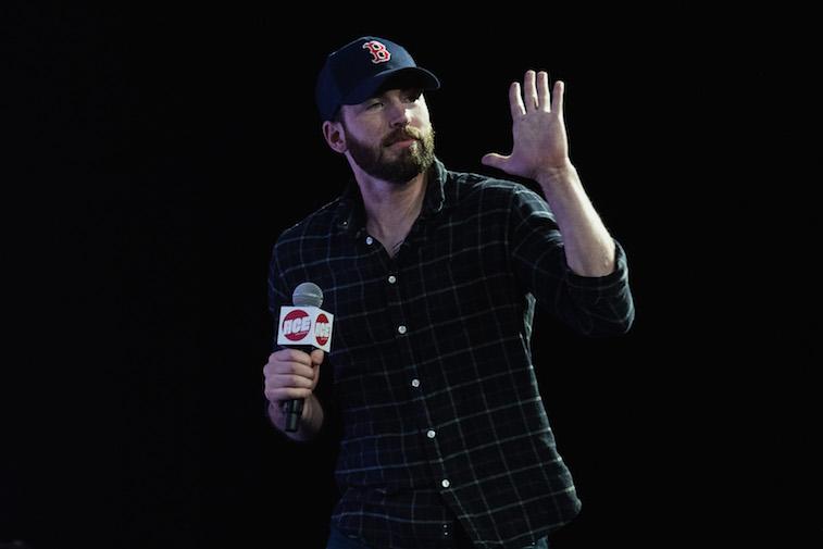 Chris Evans speaks on stage