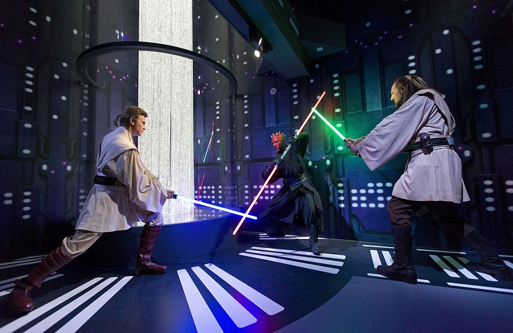 Wax figures of Obi-Wan Kenobi, Darth Maul, and Qui Gon Jinn at the Star Wars At Madame Tussauds attraction in London set up in the 'Duel of the Fates' scene from 'The Phantom Menace'
