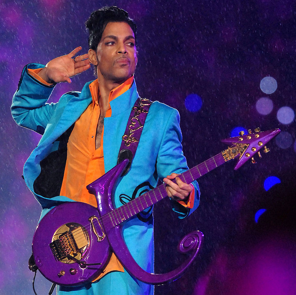 Prince with a purple guitar
