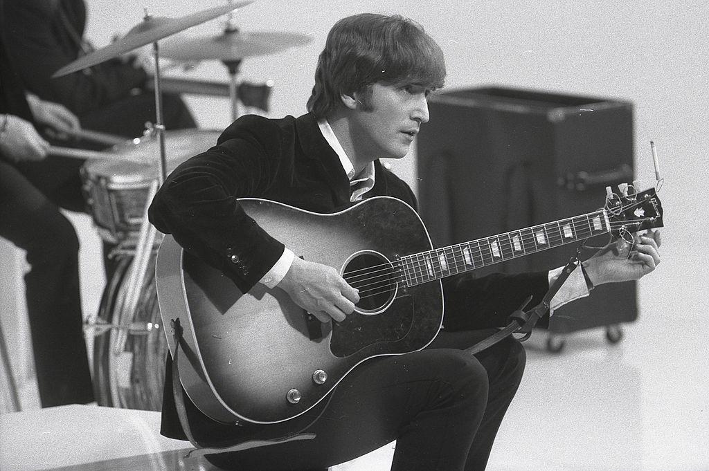 John Lennon with a guitar