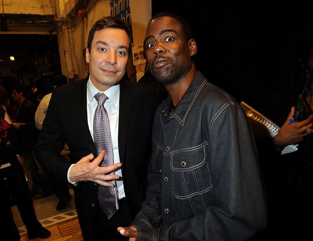 Jimmy Fallon standing next to Chris Rock