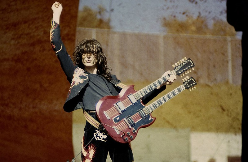 Jimmy Page performing with a double-neck guitar