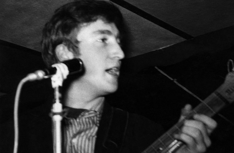 John Lennon onstage in early Beatles days