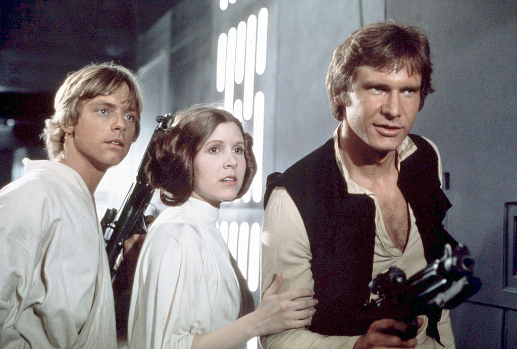 Mark Hamill, Carrie Fisher, and Harrison Ford on the set of 'Star Wars: Episode IV - A New Hope.'