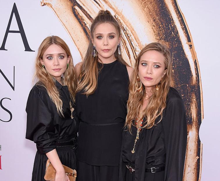 Elizabeth Olsen with sisters Mary-Kate and Ashley Olsen